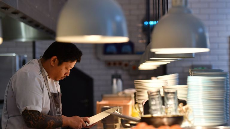 A chef prepares food in Charlotte's W5 restaurant in Ealing, west London on September 19, 2017