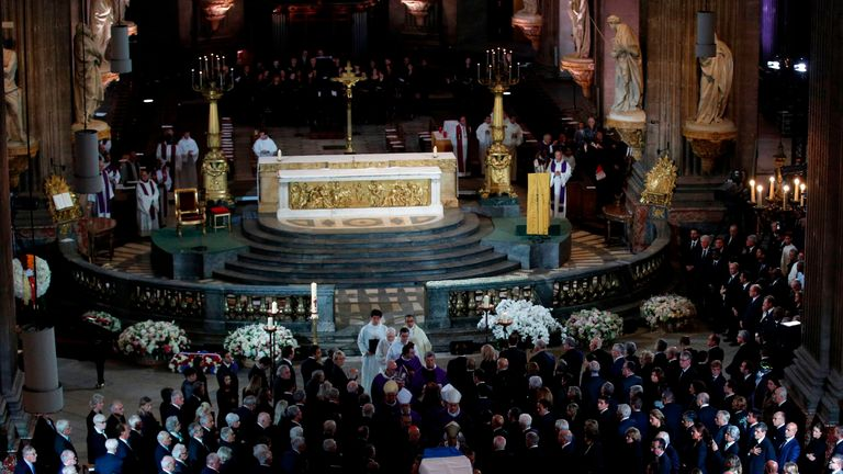 The coffin of Jacques Chirac is carried from the Saint Sulpice Church to a waiting hurst