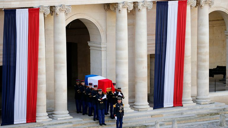 Honor guards carry the flag-drapped coffin of late French President Jacques Chirac