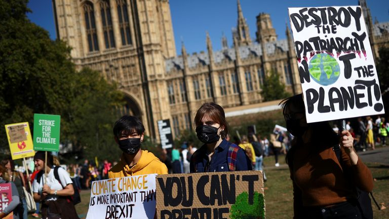 Students attend a climate change demonstration in London