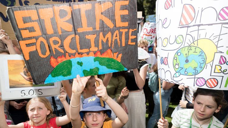 Young protesters hold up signs during Climate Strike at the Domain on September 20, 2019 in Sydney, Australia