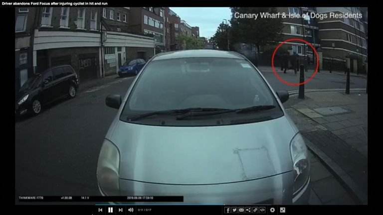 Two men (circled) were filmed running away after the car crashed