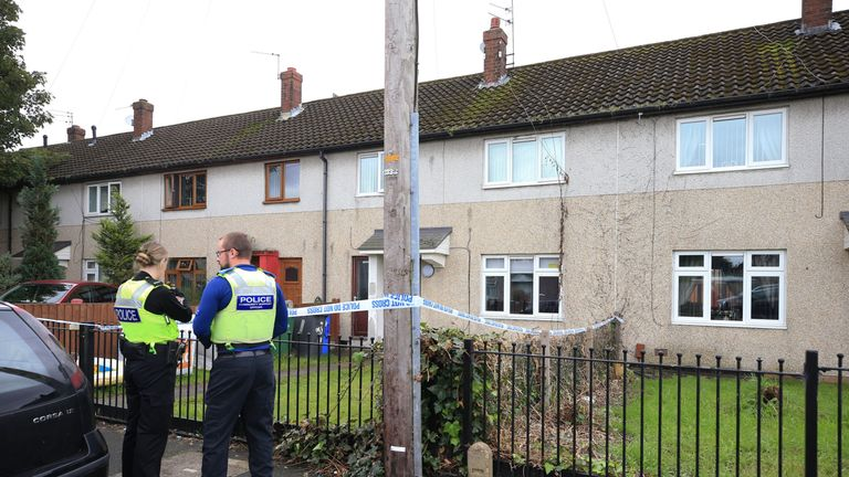 Police officers at a property on Graham Road in Widnes in Cheshire