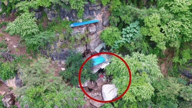 Drones captured aerial shots of the fugitive's cave hideout