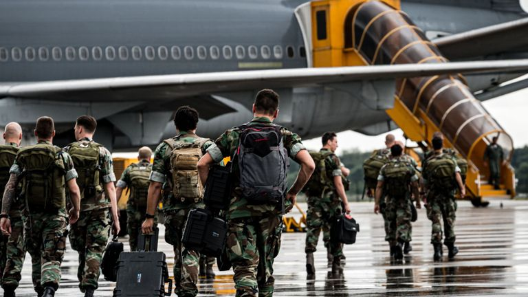 Dutch soldiers arrive at the Eindhoven Air Base to board a plane to the Caribbean to provide emergency relief to those affected by Hurricane Dorian in the Bahamas, on September 7, 2019, in Eindhoven