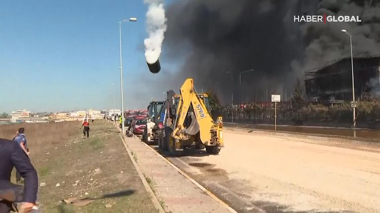 A drum descends after flying skyward following an explosion at a factory in Turkey