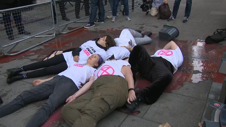 Activists lay outside a London Fashion Week venue