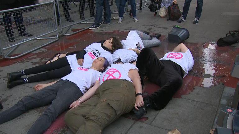 Activists lay outside a London Fashion Week venue