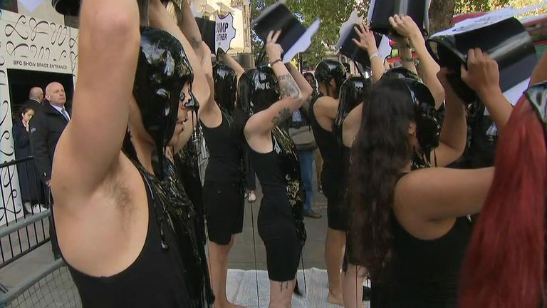 Activists poured black liquid on themselves in protest against the fashion industry using leather