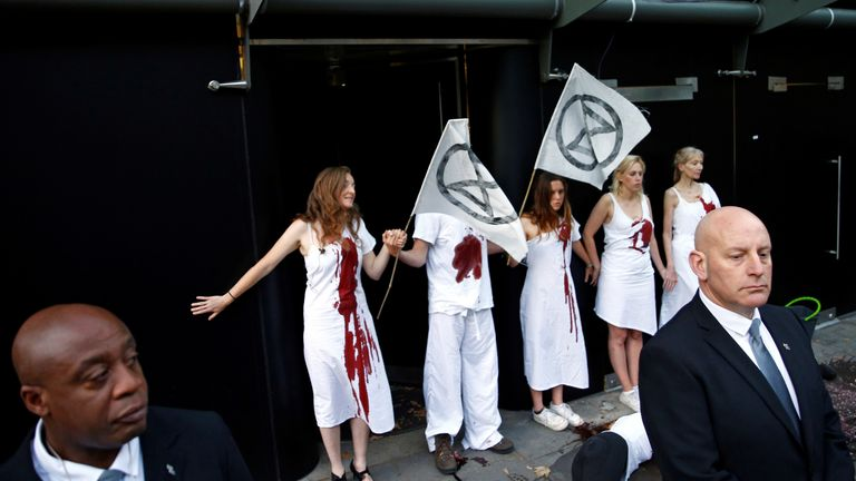 Several Extinction Rebellion protesters glued themselves to the door of a London Fashion Week venue