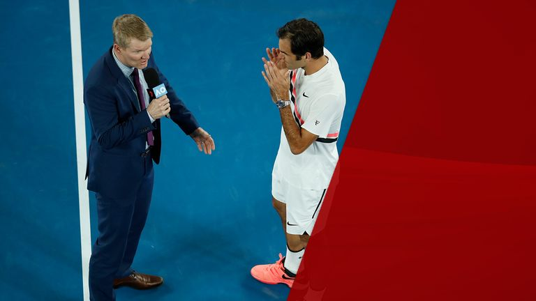 Roger Federer of Switzerland is interviewed by commentator Jim Courier after winning his semi-final match against Hyeon Chung of South Korea on day 12 of the 2018 Australian Open at Melbourne Park on January 26, 2018 in Melbourne, Australia. (Photo by XIN LI/Getty Images)