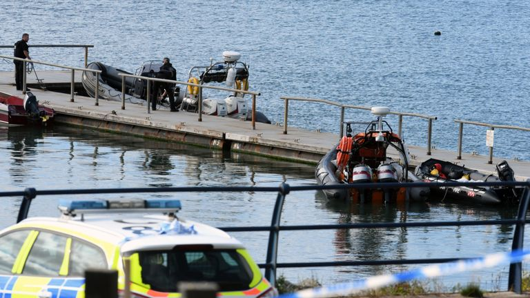 Police at the scene at the Neyland Yacht Club . Pic: Martin Cavaney