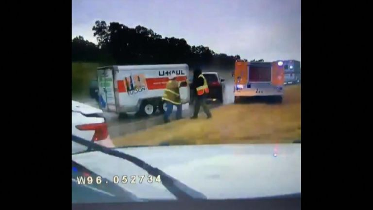 Two firefighters have survived being struck by a U-Haul as they were at the scene of a crash in Oklahoma.