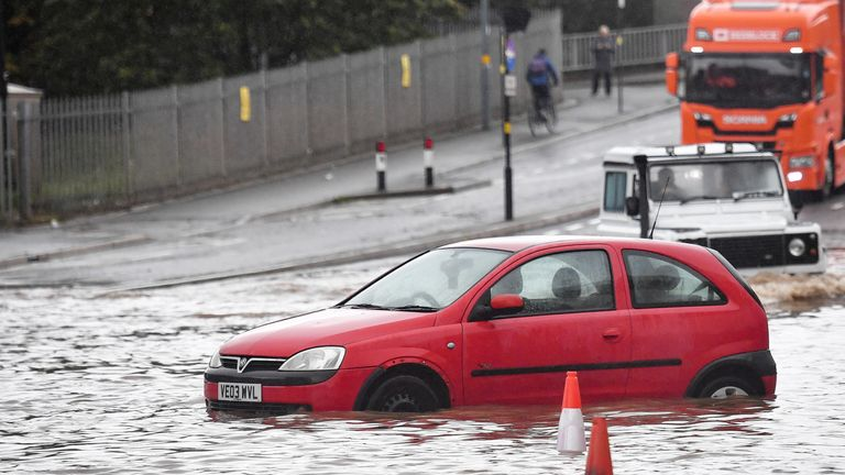 A stranded car sits on a flooded road in Birmingham city centre. The Met Office has issued a yellow weather warning for much of England and Wales today, with flooding expected in some areas. PA Photo. Picture date: Tuesday September 24, 2019. See PA story WEATHER Rain. Photo credit should read: Jacob King/PA Wire