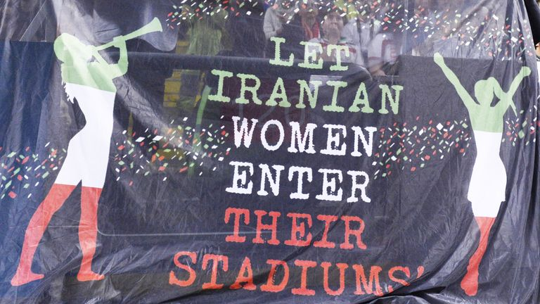 Supporters hold a banner calling for Iranian women to be allowed to enter football stadiums, during a match between Sweden and Iran in Solna near Stockholm in March 2015