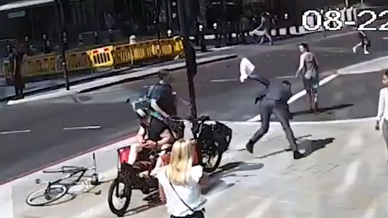 The cyclist headbutted the man, leaving him with a facial wound and arm injury