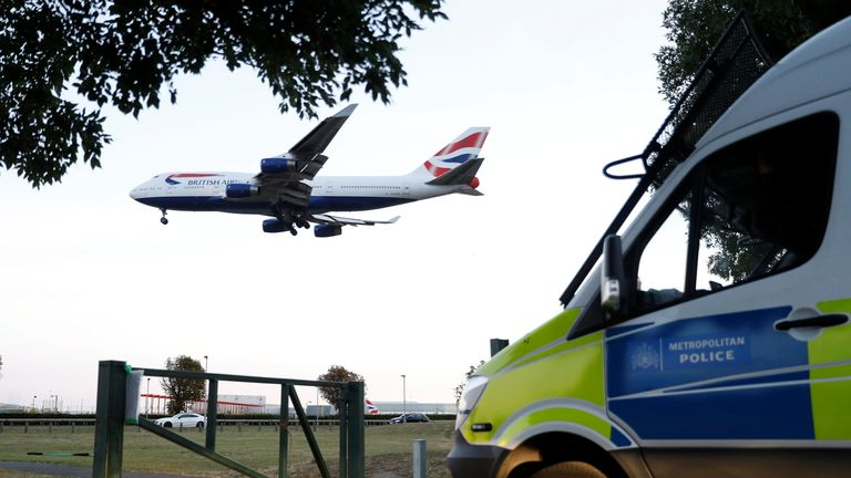 Police vehicles parked near Heathrow airport after climate activists said they planned to fly drones near the airport