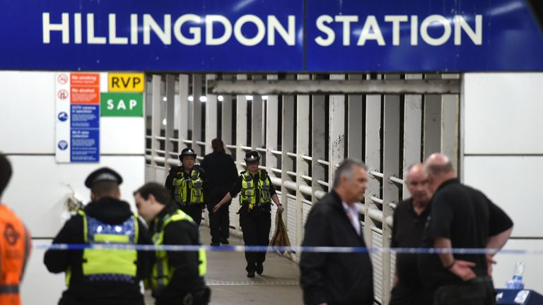 Police outside Hillingdon underground station in London, where a murder investigation has been launched after a man was stabbed to death