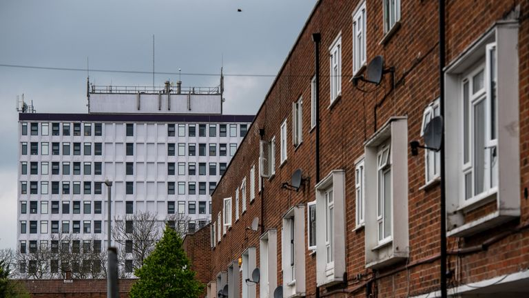 Terminus House, a disused office building now being used for social housing, stands behind a street of residential housing on April 29, 2019 in Harlow, England.
