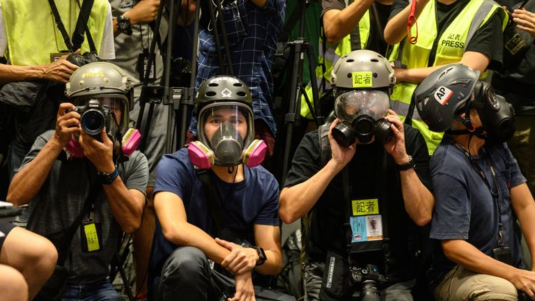 Journalists wore protective gear and high visibility vests during a news conference