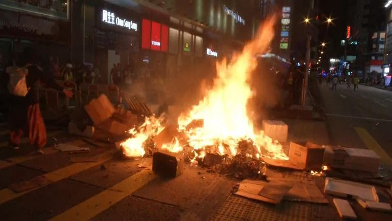 Crowds have lit fires in the streets of Hong Kong in the latest clash between protesters and police.