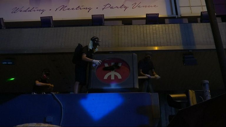 A Hong Kong protest descended into violence and vandalism when protesters attacked bystanders and dismantled signs.