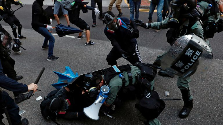 Protesters clash with riot police during a march at Tuen Mun