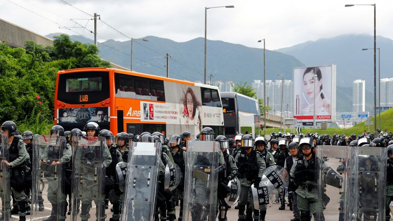 Riot police were seen lined up outside the barricaded airport