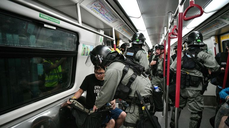 Police searched people on an underground train in Hong Kong on Sunday