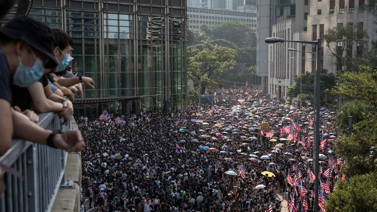 Tens of thousands of protesters walk through Central district to petition the US Consulate