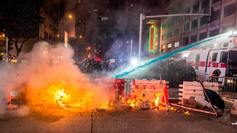 Water cannon is used to put out a fire in Hong Kong
