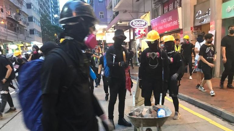 Protesters carried a wheelbarrow full of bricks as demonstrations turned violent