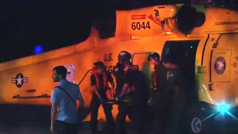 Injured people from a clinic in Great Abaco Island's Marsh Harbour arrive after being evacuated in a US Coast Guard helicopter to be treated in Nassau, Bahamas