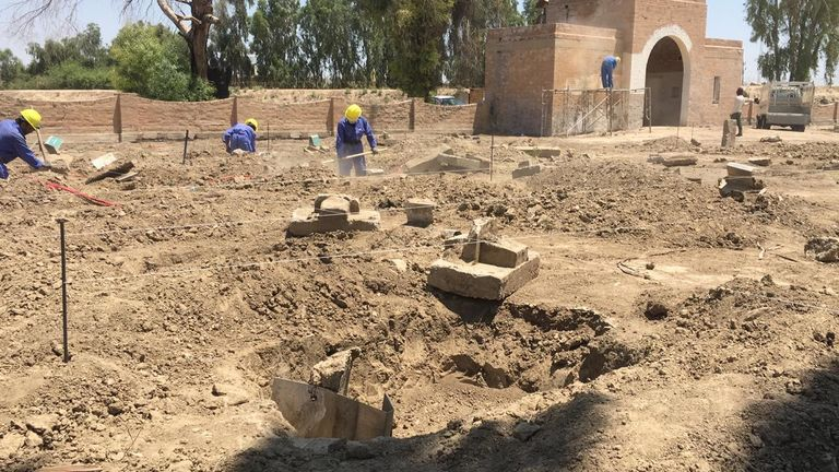Workers preparing the ground for nearly 300 new headstones at the Habbaniya War Cemetery in the Iraqi desert