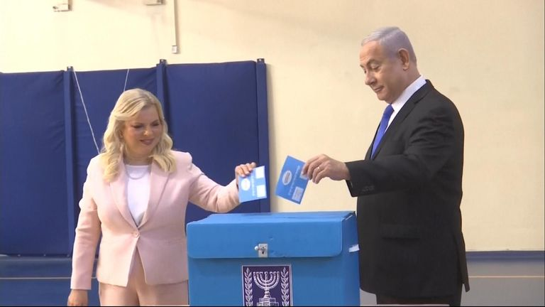 Israeli Prime Minister Benjamin Netanyahu and his wife Sara cast ballots in parliamentary elections in Jerusalem