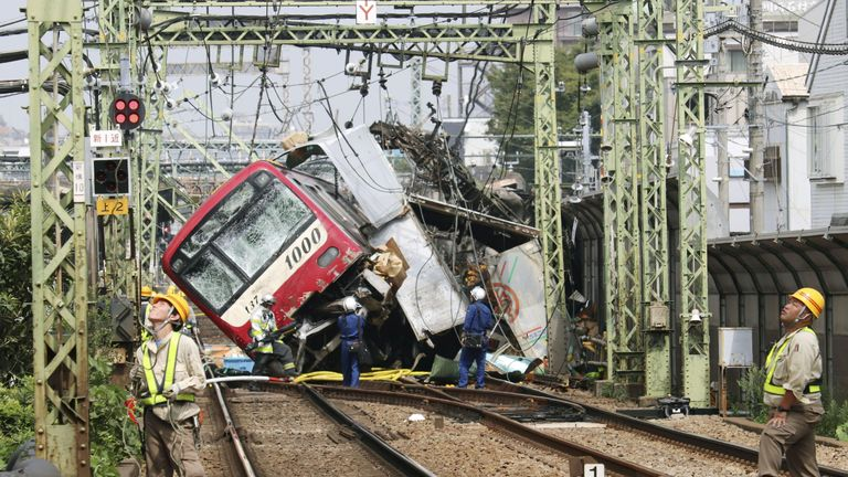 A train is derailed after a collision with a truck in Yokohama, near Tokyo