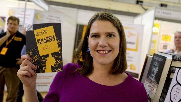 BOURNEMOUTH, ENGLAND - SEPTEMBER 14: Liberal Democrat leader Jo Swinson signs their 'Bollocks to Bexit' manifesto as she tours the trade stands in the exhibition hall at the Liberal Democrat Party Conference at the Bournemouth International Centre on September 14, 2019 in Bournemouth, England. (Photo by Finnbarr Webster/Getty Images)