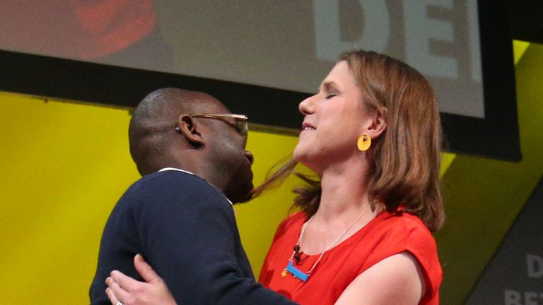 Party leader Jo Swinson hugs her new MP Sam Gyimah