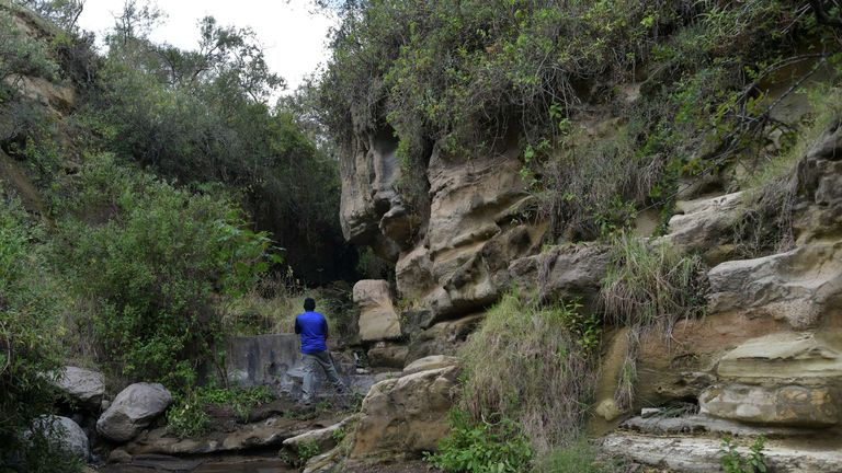 A man stands a section of the gorge at Hell's Gate National Park