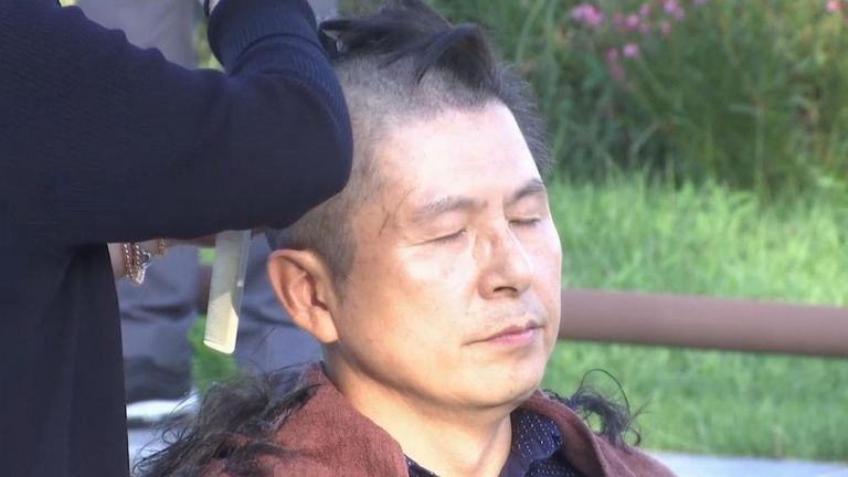 South Korea's main opposition leader shaved his head to show dissent over President Moon Jae-in and Justice Minister Cho Kuk