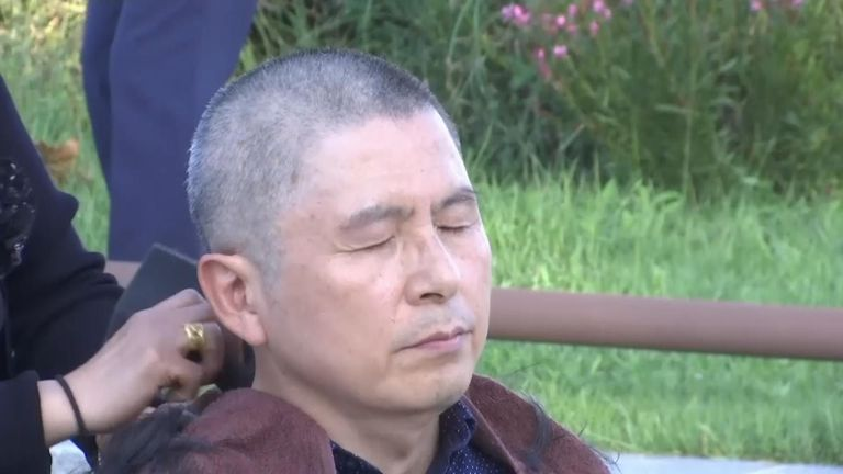 The leader of South Korea's main opposition party shaved his head in Seoul to show dissent over South Korean President Moon Jae-in and Justice Minister Cho Kuk