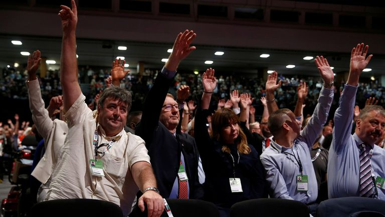 Len McCluskey (2-L), Unite the Union's general secretary, votes with other colleagues after the Brexit debate during the Labour party annual conference in Brighton