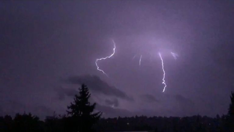 An estimated 200 lightning strikes lit the night sky over Seattle as a thunderstorm swept over western Washington.