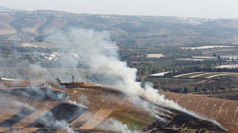 Smoke rises in Maroun Al-Ras from shells fired from Israel