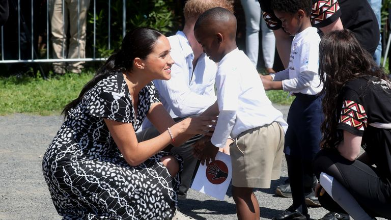 Meghan, Duchess of Sussex meets young wellwishers as they visit a Justice Desk initiative in Nyanga township, during their royal tour of South Africa