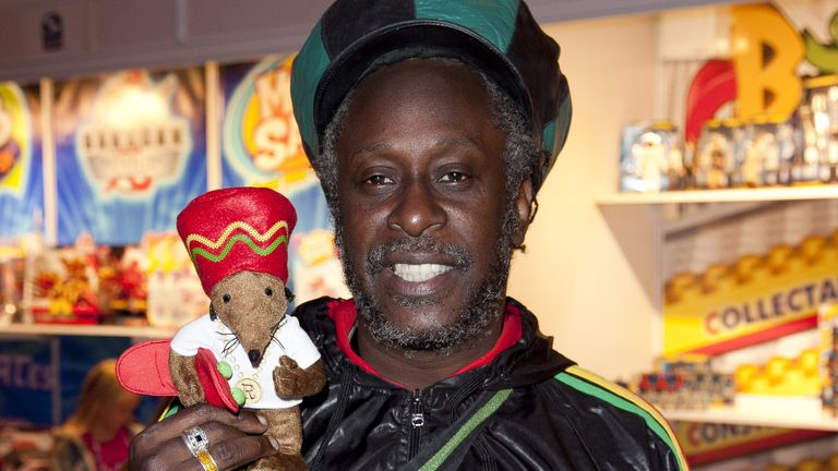 Michael De Souza is pictured with a stuffed toy version of Rastamouse in 2011