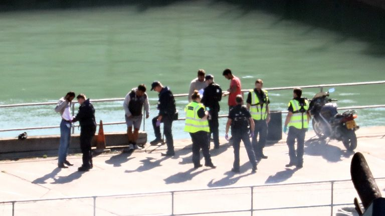 A group of men thought to be migrants are checked by Border Force officers in Dover