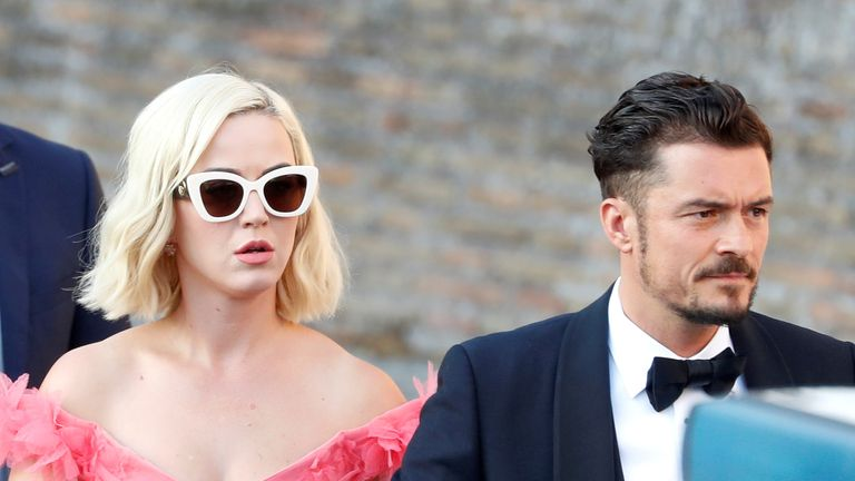 Singer Katy Perry and actor Orlando Bloom arrive to attend the wedding