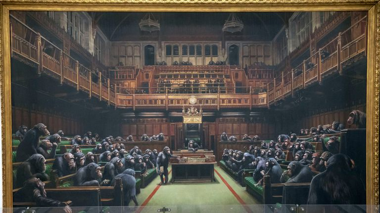 The painting 'Devolved Parliament' by the graffiti artist Banksy is going up for auction
