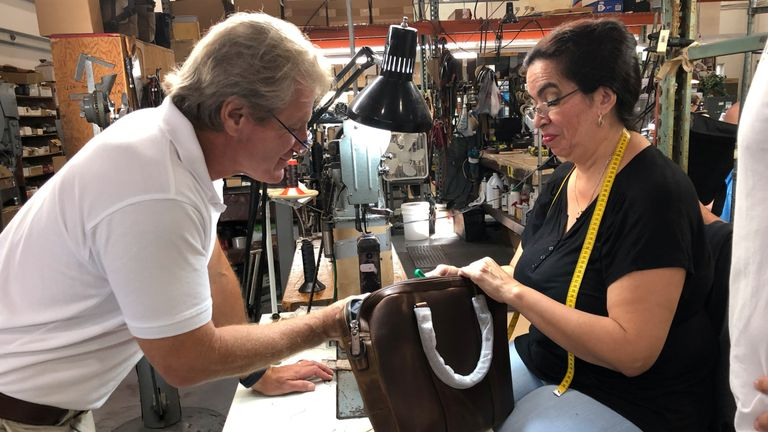 CEO Michael Korchmar inspects a bag being assembled by Martha Saray